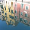 Photo: Colorful buildings reflected
