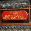 Photo: Sign: Don't touch mother of pearl