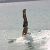 Photo: Surfer doing headstand