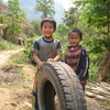 Photo: Boys with tire